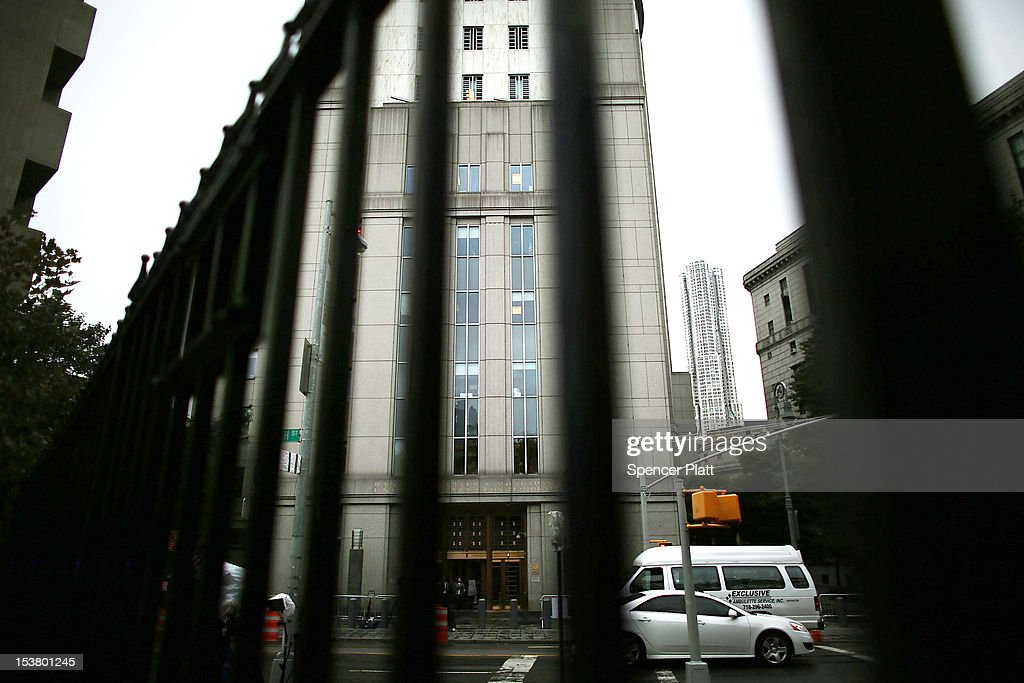 The U.S. District Court in Manhattan stands during a court appearance for three men brought from England to New York to face terrorism charges on October 9, 2012 in New York City. Security was heightened during a hearing for Khaled al-Fawwaz, Adel Abdul Bary and Abu Hamza al-Masri to learn how their cases will proceed to trial. Al-Masri, the one armed Egyptian-born preacher, faces charges that he attempted to set up a terrorist training camp in Oregon and assisted in the abduction of 16 hostages, two of them American tourists, in Yemen in 1998. Both al-Fawwaz and Abdul Bary face charges that they participated in the bombings of embassies in Tanzania and Kenya in August 1998.