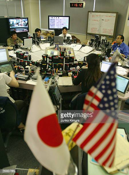 The US dollar against the Japanese yen flashes on a board in a dealing room May 15 2003 in Tokyo Japan The US dollar fell below the 116 yen line for...
