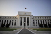 The US Federal Reserve building is seen on August 08 2011 in Washington DC after Standard Poor's cut the US rating from its topflight tripleA one...