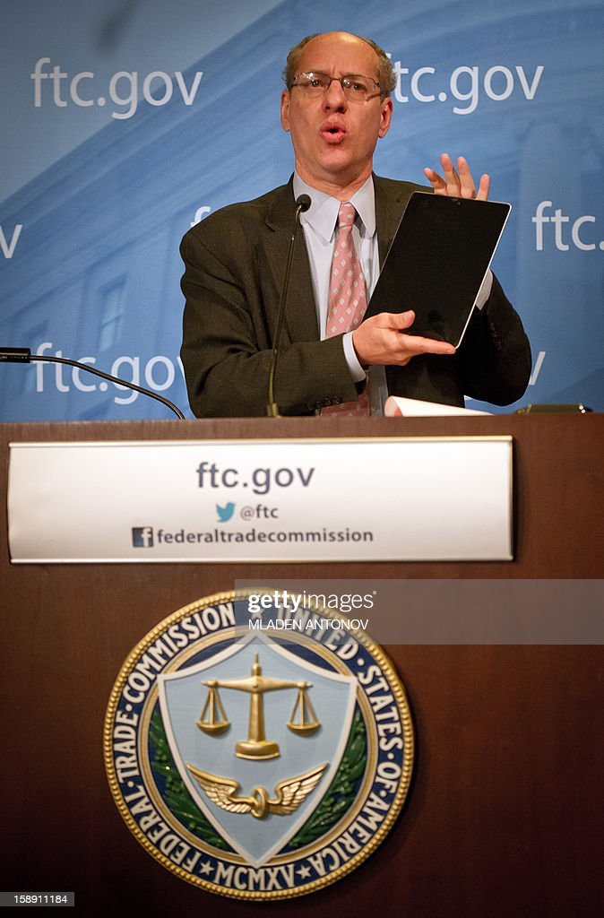 The US Federal Trade Commission Chairman Jon Leibowitz shows an IPad while speaks at a press conference in Washington, DC on January 3, 2013. Jon Leibowitz made an announcement concerning the investigation of Google, one of the largest technology companies in the world, for alleged anticompetitive conduct. AFP PHOTO/MLADEN ANTONOV