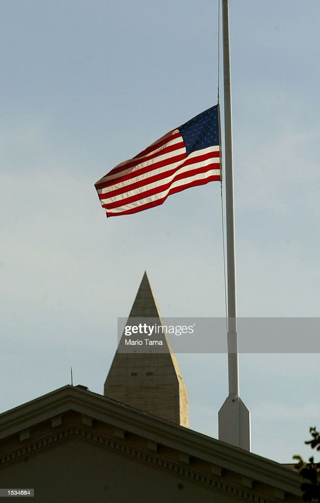 The US flag above the White House flies at halfmast in honor of Senator Paul Wellstone October 26 2002 in Washington DC Wellstone died in a place...