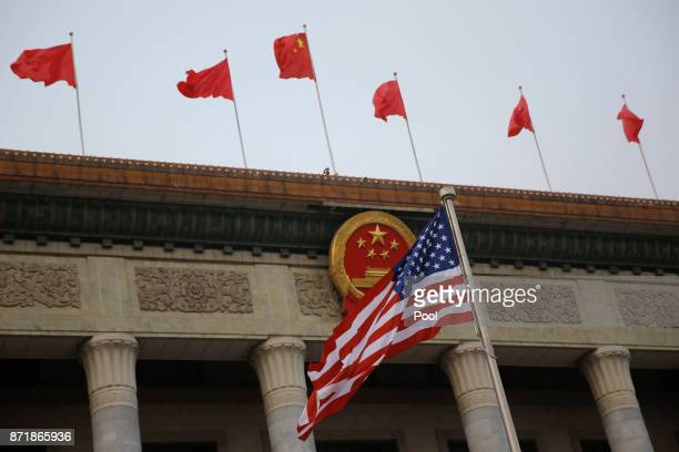The US flag and Chinese flags fly at a welcoming ceremony between Chinese President Xi Jinping and US President Donald Trump November 9 2017 in...