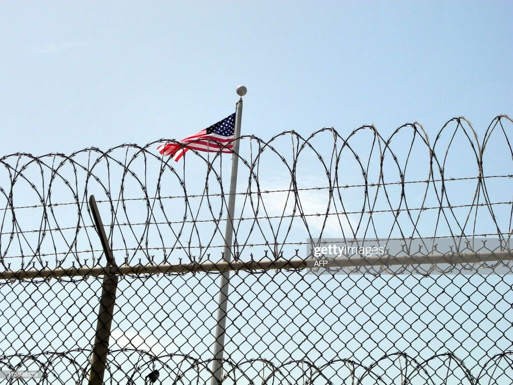 The US flag at the US Naval Base in Guantanamo Bay Cuba on August 6 2013 AFP PHOTO/CHANTAL VALERY