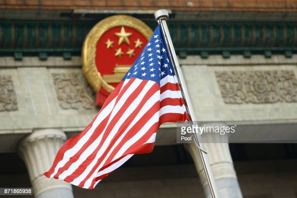 The US flag flies at a welcoming ceremony between Chinese President Xi Jinping and US President Donald Trump November 9 2017 in Beijing China Trump...