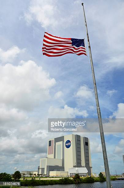 The US flag flies at half mast outside the Vehicle Assembly Building in honor of Neil Armstrong at the Kennedy Space Center August 31 2012 in Cape...