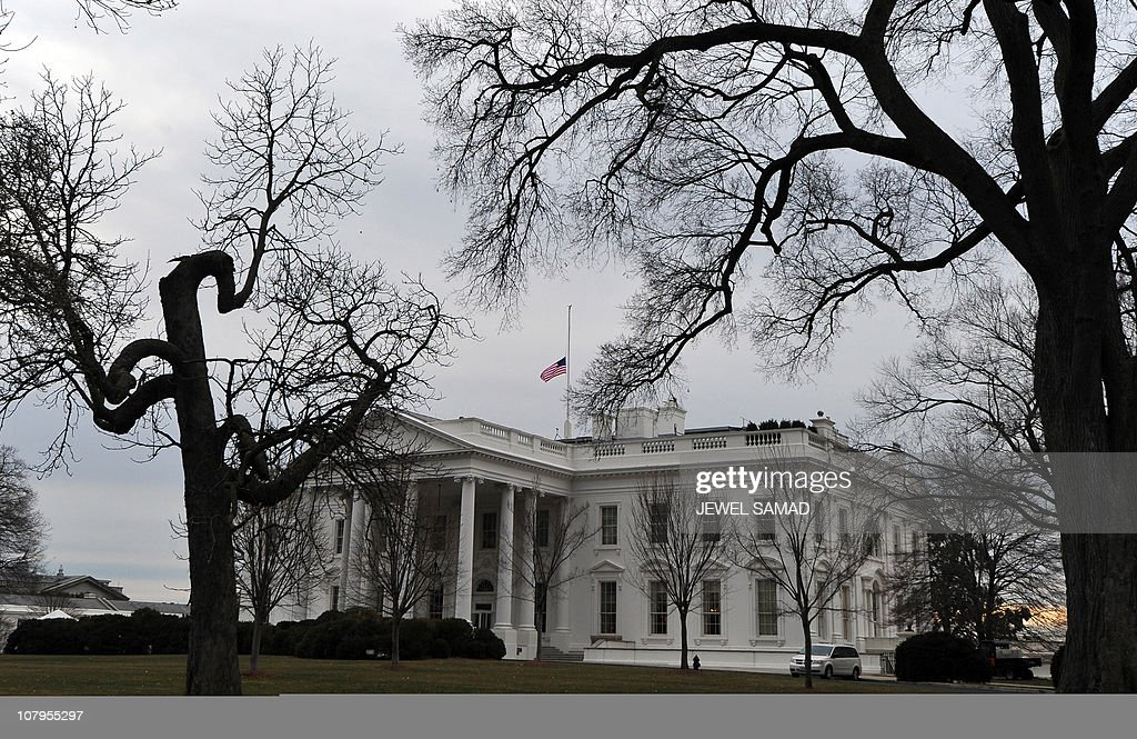 The US flag flies at halfmast above the White House in Washington DC on January 10 2011 to morn for the victims of a shooting at an Arizona political...