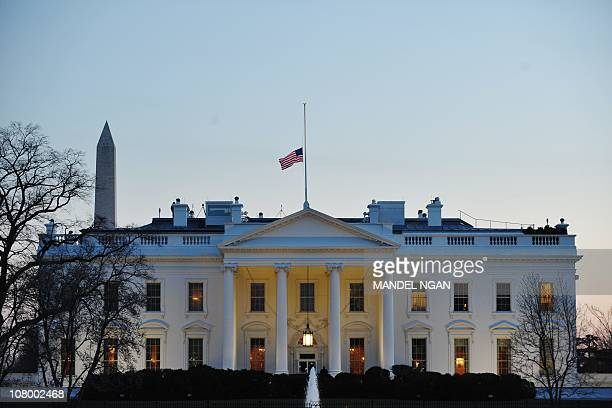 The US flag flies at halfstaff above the White House on January 9 2011 in Washington US President Barack Obama ordered flags to be flown at halfstaff...