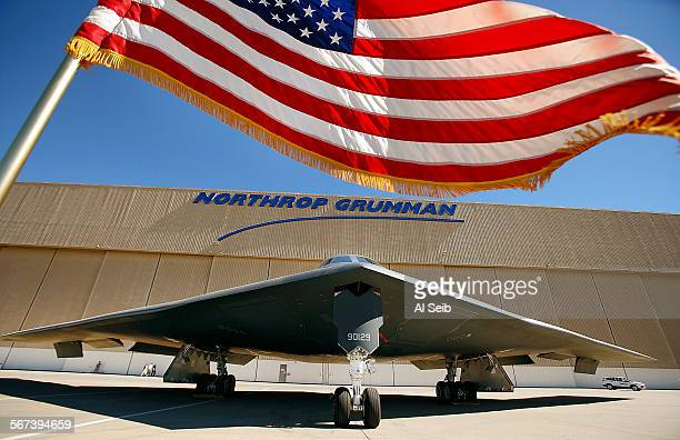 PALMDALE CA JULY 17 2014 The US flag flies near the US Air Force's B2 Spirit Stealth bomber 'Spirit of Georgia' at the Northrop Grumman Corp facility...