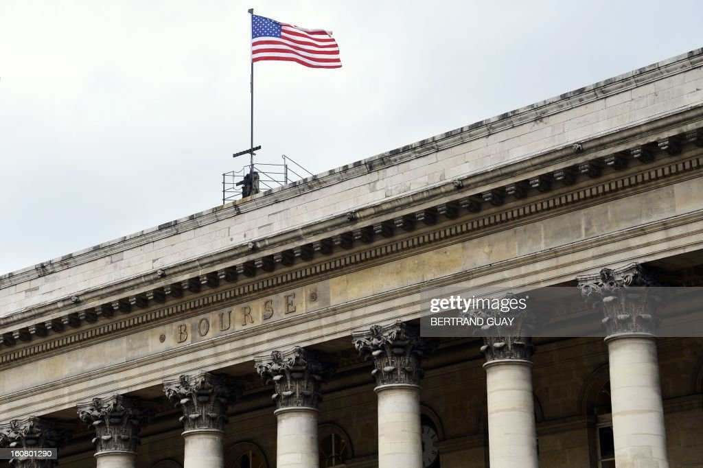 The US flag is pictured on the roof of French Palais Brongniart former Paris' stock exchange on February 6 2013 in Paris during the filming of US...