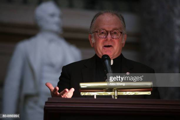 The US House Chaplain Father Pat Conroy speaks during a memorial service at the National Statuary Hall of the Capitol September 27 2017 in Washington...