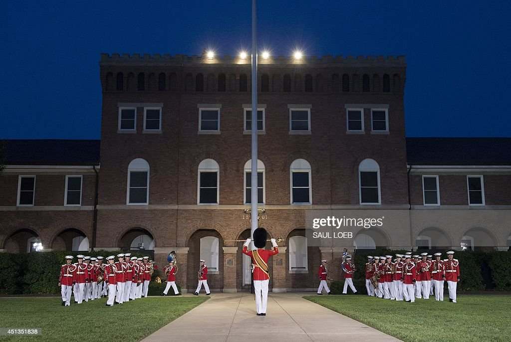 The US Marine Band performs during the Marine Barracks Evening Parade at the Marine Barracks in Washington DC June 27 2014 The parade includes...
