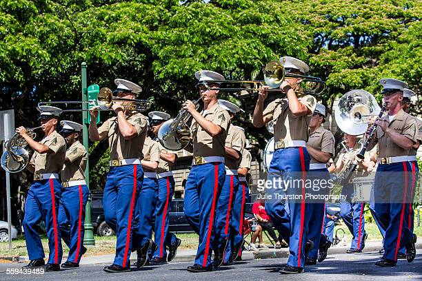 The US Marine Corps Pacific Band in military uniforms marching and playing in the annual local downtown King Kamehameha Day Parade in Honolulu Hawaii...