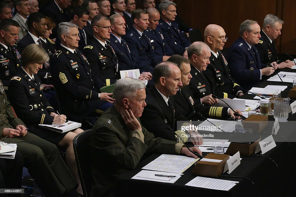 The U.S. military Joint Chiefs of Staff (L-R) Commandant of the Marine Corps Gen. James Amos, Chief of Naval Operations Adm. Jonathan Greenert, Vice Chairman of the Joint Chiefs of Staff Adm. James Winnefeld, Chairman of the Joint Chiefs of Staff Gen. Martin Dempsey, Chief of Staff of the Army Gen. Raymond Odierno, Chief of Staff of the Air Force Gen. Mark Welsh III and Chief of the National Guard Bureau Gen. Frank Grass testify before the Senate Armed Services Committee on Capitol Hill May 6, 2014 in Washington, DC. Joined by senior enlisted officers, the Joint Chiefs testified about proposals relating to military compensation.
