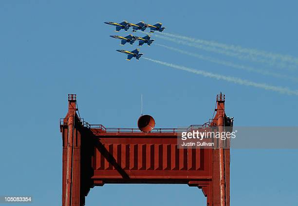 The US Navy Blue Angels F/A18 Hornets fly over the Golden Gate Bridge on October 8 2010 in San Francisco California The Blue Angels were practicing...