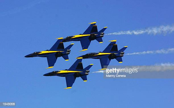 The US Navy's Blue Angels performs an aerobatic maneuver with the the an F/A18 Hornet May 16 2002 at at Andrews Air Force Base MD The US Navy's...