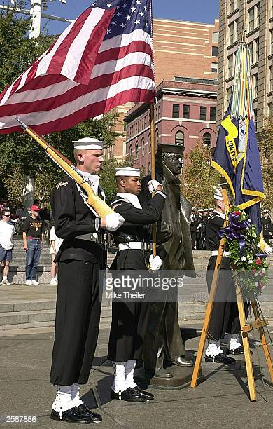 The US Navy''s Ceremonial Guard participate in a ceremony at the US Navy Memorial''s 'The Lone Sailor' statue October 13 2003 in Washington DC The...