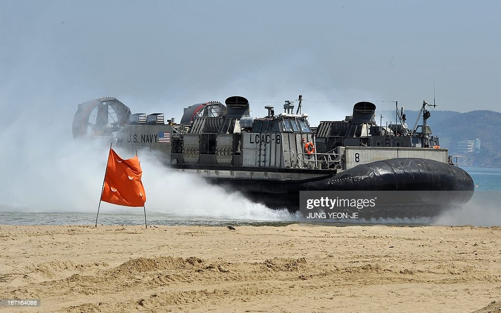 The US Navy's landing craft air cushion (LCAC) approaches the beach during the Combined Joint Logistics Over the Shore (CJLOTS) exercise in Pohang, 260 kms southeast of Seoul, on April 22, 2013. The wait for North Korea's expected missile test, which has kept South Korean and US forces on heightened alert for the past two weeks, may stretch to July, the South's defence ministry said on April 22.