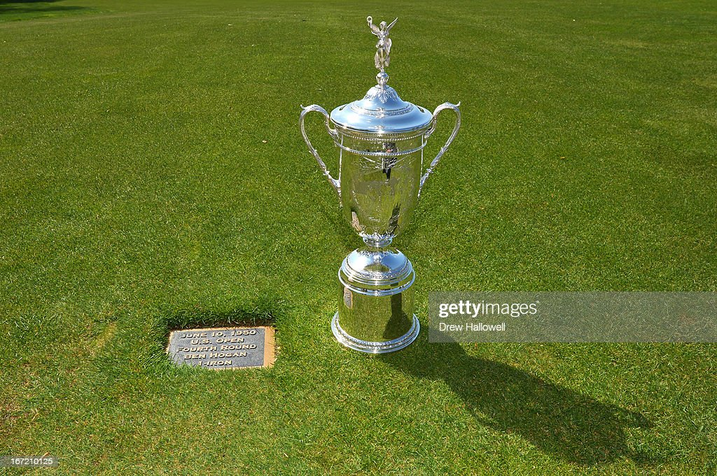 The U.S. Open Championship Trophy rests on the 18th fairway next to a plaque commemorating the famous shot by Ben Hogan in 1950 on the East Course at Merion Golf Club on April 22, 2013 in Ardmore, Pennsylvania. Merion Golf Club is the site for the 2013 U.S. Open that will be played on June 13-16.