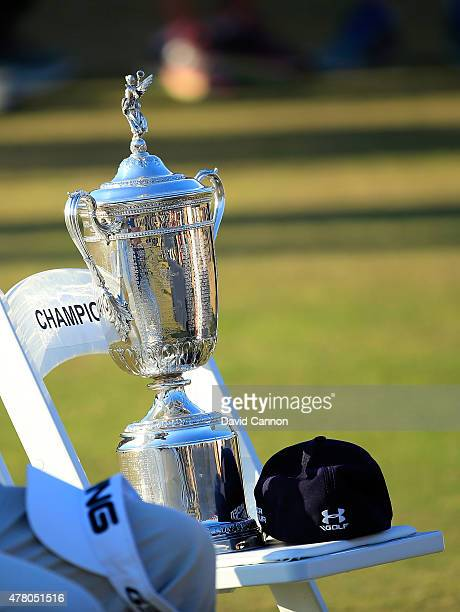 The US Open trophy is seen on Jordan Spieth's chair and alongside his hat during the trophy presentation after Spieth won the 115th US Open...