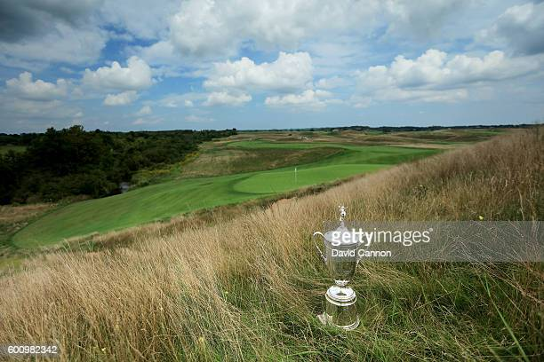The US Open Trophy on the hill behind the 14th green during the USGA Media Day at Erin Hills Golf Course the venue for the 2017 US Open Championship...