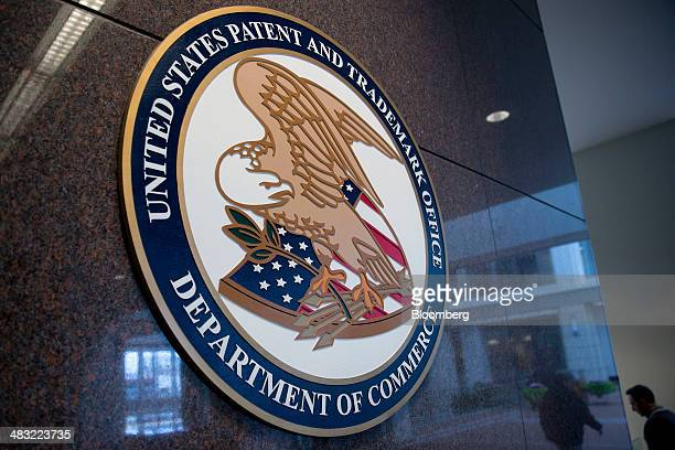 The US Patent and Trademark Office seal is displayed inside the headquarters in Alexandria Virginia US on Friday April 4 2014 The Senate Judiciary...