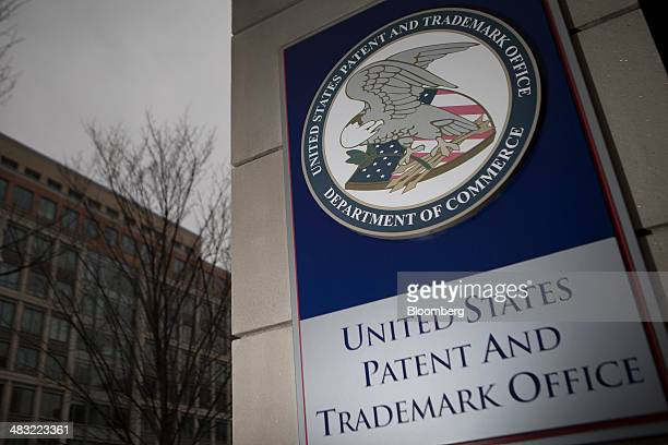 The US Patent and Trademark Office seal is displayed outside the headquarters in Alexandria Virginia US on Friday April 4 2014 The Senate Judiciary...