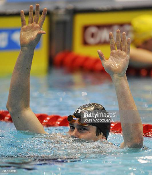 The US' Peter Marshall celebrates after setting a new world record in the men's 100m backstroke race with a time of 4963 sec during the seventh and...