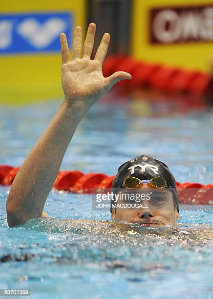 The US' Peter Marshall cellebrates after setting a new world record in the men's 100m backstroke race with a time of 4963 sec during the seventh and...