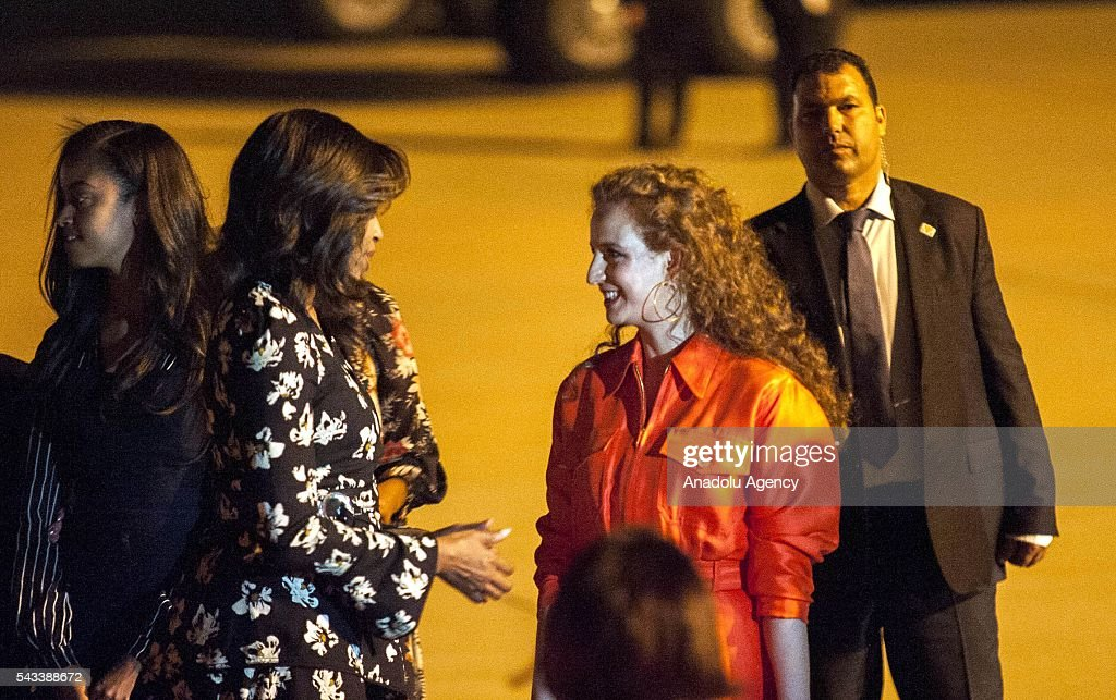The US President Barrack Obama' s wife Michelle Obama (L 2) speaks with Princess Lalla Salma of Morocco (R 2) upon her arrival at the Menara Airport in Marrakech, Morocco on June 28, 2016. Michelle Obama arrived in Marrakech to promote the education of girls.