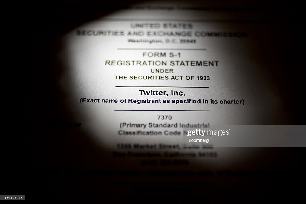 The U.S. Securities and Exchange Commission's Form S-1, filled out by Twitter Inc., is arranged for a photograph in Washington, D.C., U.S., on Monday, Oct. 28, 2013. Twitter Inc., which embarks on its road show to investors today, will make the case to potential investors in its initial public offering that it needs to keep spending to grow, and profit will come once it can reap the benefits of those investments. Photographer: Andrew Harrer/Bloomberg via Getty Images
