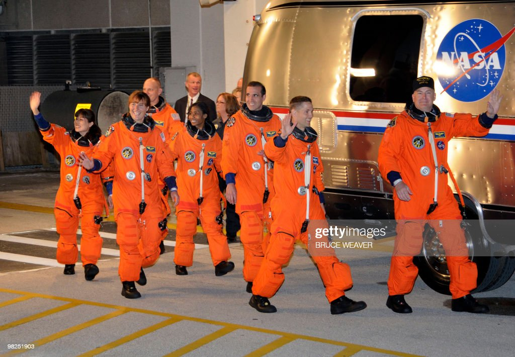 The US space shuttle Discovery crew early on April 5, 2010 leave the crew's quarters at Kennedy Space Center as they leave for launch pad 39A in Florida in preparation for their mission to the International Space Station. Pictured are crewmembers (L to R) Naoko Yamazaki of Japan, Dorothy Metcalf-Lindenburger, Clayton Anderson, Stephanie Wilson, Rick Mastracchio, pilot James Dutton Jr and commander Alan Poindexter. Discovery will carry a multi-purpose logistics module filled with science racks for the laboratories aboard the International Space Station. AFP PHOTO / Bruce WEAVER