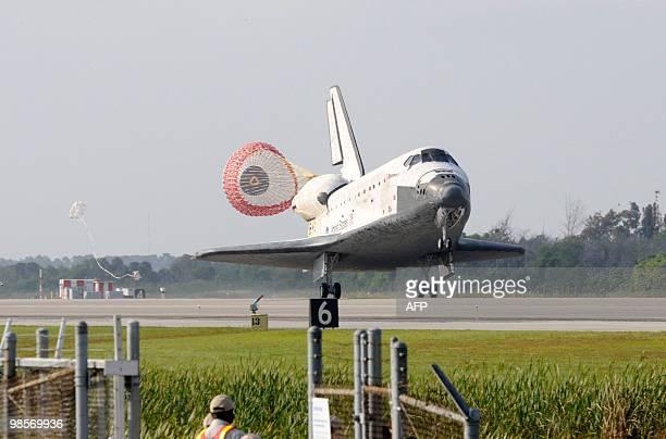 during a space shuttle landing a parachute deploys - photo #45