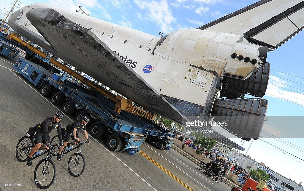 The US Space Shuttle Endeavour is moved from Westchester Square to Randy's Donuts during its final ground journey in Los Angeles, California on October 12,2012. Over the next two days, the 170,000-pound (77,272 kg) shuttle will travel at no more than 2 mph (3.2 km per hour) along a 12-mile (19km) route from LAX to it's final home at the California Science Center. NASA Space Shuttle Program ended in 2011 after 30 years and 135 missions.