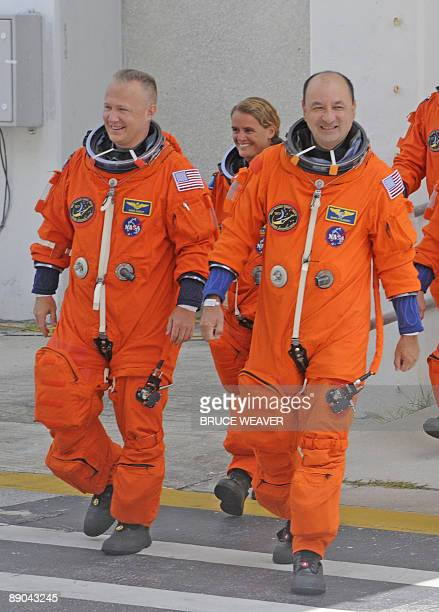 The US space Shuttle Endeavour's crewmembers Pilot US Doug Hurley Canadian Julie Payette and Commander US Mark Polansky are all smiles July 15 2009...
