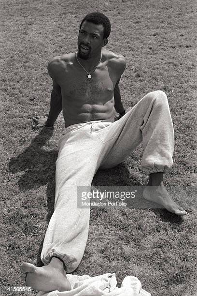 The US sprinter John Carlos sat down on a lawn during a training session prior to the Olympic competitions Carlos shall win a bronze medal in the 200...