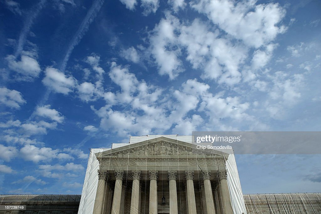The U.S. Supreme Court building is draped in a photo-realistic sheet during a repair and preservation project November 30, 2012 in Washington, DC. The justices met today to consider hearing several cases dealing with the rights of gay couples who are married, want to get married or are in domestic partnerships.