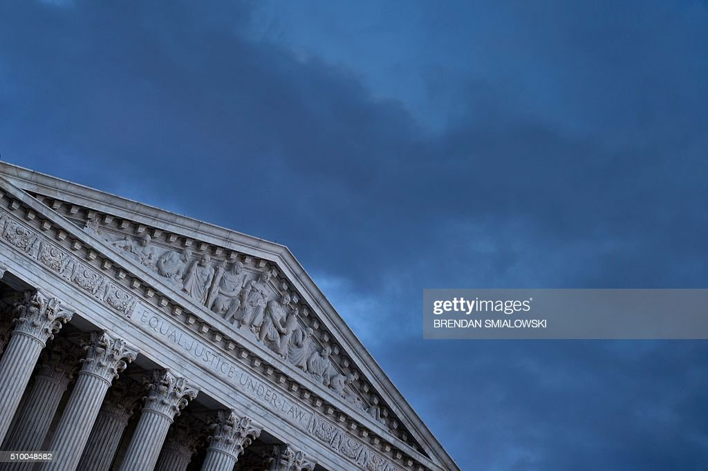 The US Supreme Court is seen February 13, 2016 in Washington, DC, following the announcement of the death of Supreme Court Justice Antonin Scalia. Scalia, a fiery conservative who helped shape American legal thought, was first appointed to the highest court in the land in 1986 by President Ronald Reagan, making him the first Italian-American to serve there. Scalia was 79. / AFP / Brendan Smialowski