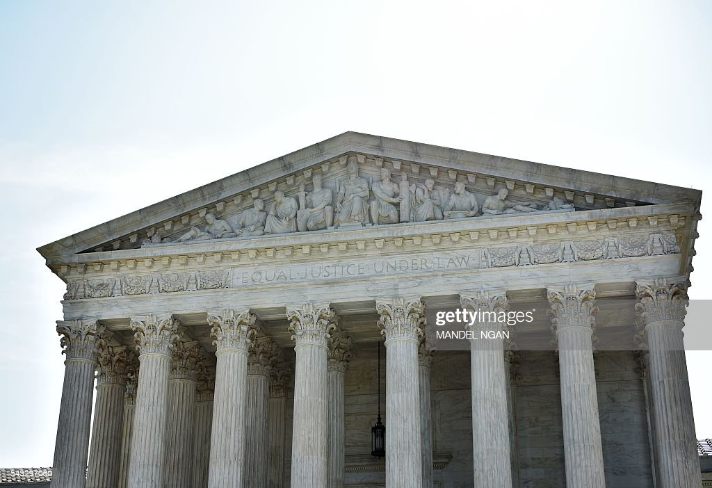 The US Supreme Court is seen on June 27, 2016 in Washington, DC. The US Supreme Court on Monday struck down a Texas law placing a raft of restrictions on abortion clinics, handing a major victory to the 'pro-choice' camp in the country's most important abortion case in a generation. In a case with far-reaching implications for millions of women across the United States, the court ruled 5-3 to strike down measures which activists say have forced more than half of Texas's abortion clinics to close. / AFP / MANDEL