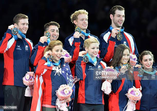 The US team Ashley Wanger Gracie Gold Madison Chock Marissa Castelli and Jeremy Abbott Max Aaron Evan Bates Simon Shnapir celebrate their win during...