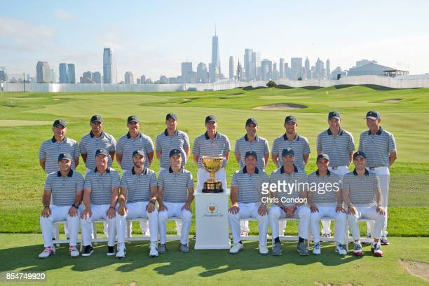 The US Team poses for a group photo with the Presidents Cup trophy prior to the start of the Presidents Cup at Liberty National Golf Club on...