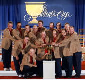 The US Team poses with the President's Cup after defeating the International Team 195 to 145 during the Closing Ceremony of The Presidents Cup on...
