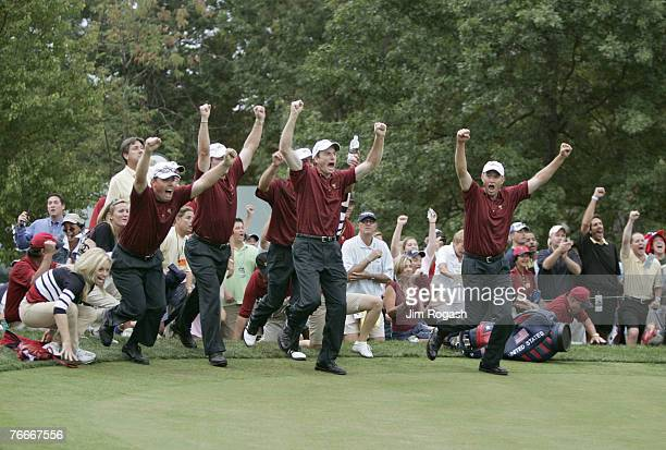 The US team rushes out to meet Chris DiMarco after he won his match to clinch the victory for the US team during the singles matches in the final...