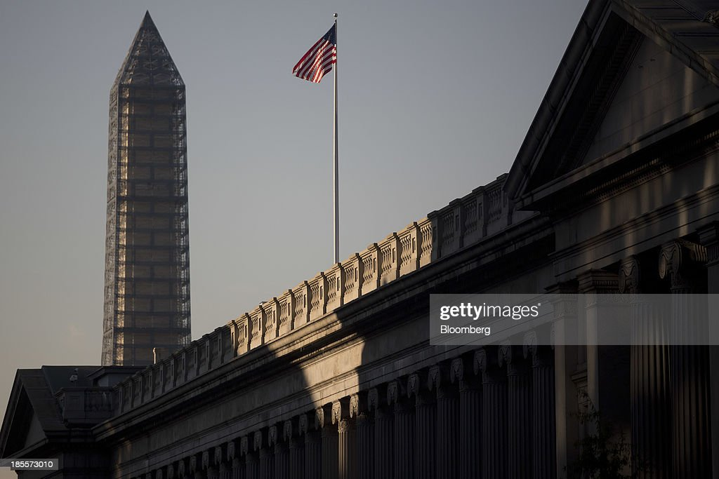 The US Treasury and Washington Monument left stand in Washington DC US on Tuesday Oct 22 2013 Bidding at the US Treasury's auction of $35 billion in...