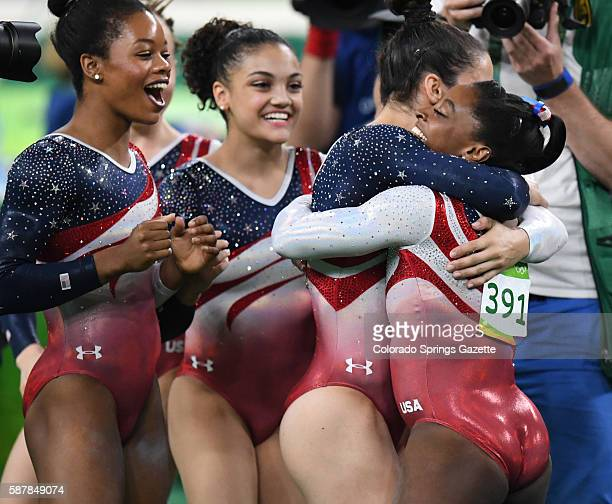 The US women's gymnastics team from left Gabrielle Douglas Lauren Hernandez and Alexandra Raisman greet teammate Simone Biles after her floor routine...