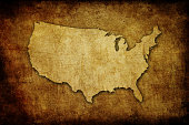 A light brown USA map overimposed above a brown vignetted old paper parchment backdrop. Grunge image technique.