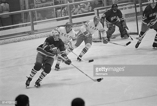 The USA Olympic Ice Hockey Team takes the puck in a game against the USSR's team at the 1972 Winter Olympic Games in Sapporo Japan