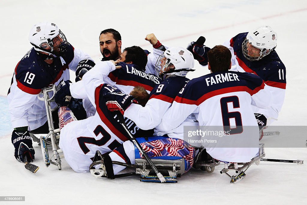 The USA team celebrate after winning the ice sledge hockey gold medal game between the Russian Federation and the United States of America at the Shayba Arena during day eight of the 2014 Paralympic Winter Games on March 15, 2014 in Sochi, Russia.