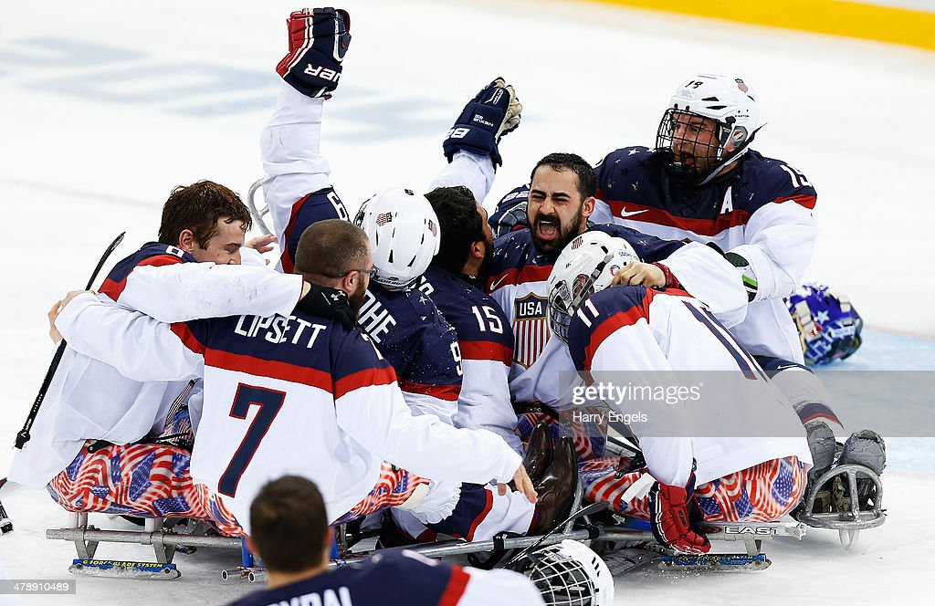 The USA team celebrate winning the Ice Sledge Hockey Gold Medal match between Russia and USA at the Shayba Arena during day eight of the 2014 Paralympic Winter Games on March 15, 2014 in Sochi, Russia.