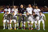 The USA team pose for a group photo during the International Friendly between the USA and Colombia at Craven Cottage on November 14 2014 in London...