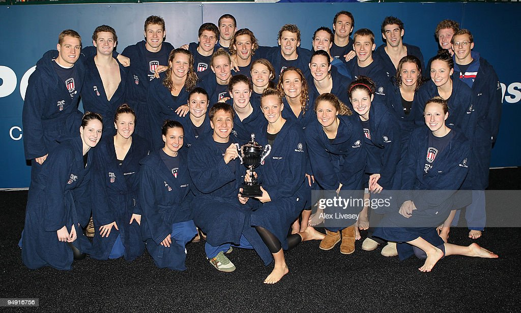 The USA team pose with the trophy following their victory at the end of day two of the Duel in the Pool between the United States and the E-Stars, a European team, at The Manchester Aquatics Centre on December 19, 2009 in Manchester, England.